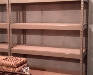 THREE metal shelves in like new condition!