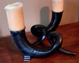 Two heavy metal horn candle holders.