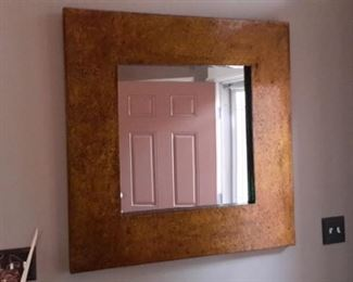 Large mirror with gold speckled frame.