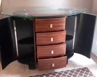 Stunning entry piece is a buffet, wine rack and more with glass top