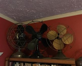 several antique fans in working condition