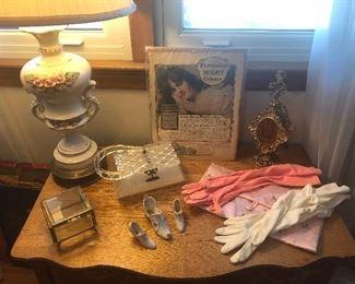 Jewelry casket, china shoes, clutch purse, evening gloves, ormulu perfume bottle, lucite box purse