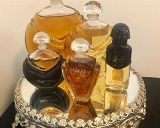 Magie Noire perfume bottles including rare department store facticr, mirrored footed tray
