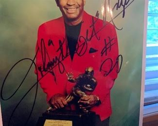Autographed Johnny Rodgers photograph with Heisman trophy
