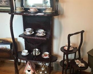 Victorian stand with mirror, tea cups and saucers