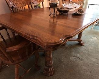 Oak Claw Footed dining table, 6 chairs, 2 leaves