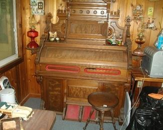 "Beautiful pump organ (w/o the ""pump"") and stool.  It's a great ""housing"" unit for an electronic keyboard.  It's a beautiful piece of furniture!  Notice the ""lamp stands"" attached.  Gorgeous."