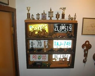 "Glass ""oilers"", license plates, Model T engine parts.  These will be outside - not behind the door."