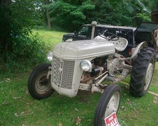 1952 FORD tractor complete with plow and chains.  Runs great!
