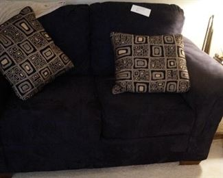 black love seat with pillows