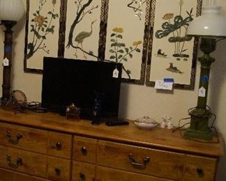 dresser, Asian inspired art, small TV, lamps