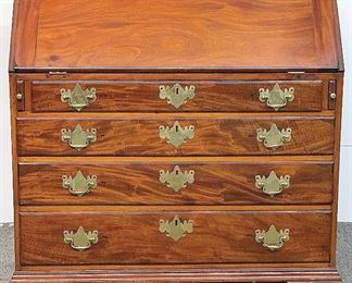 A small sampling of items in our exciting Estate Antiques Auction, August 16th, starting at 3PM!  |  Lot 297: A Chippendale walnut slant lid desk with fitted interior, dovetailed case, and ogee bracket feet. 42-1/2 in tall x 40 in wide x 22 in deep.