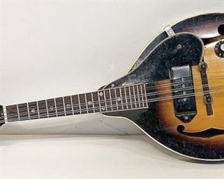 A small sampling of items in our exciting Estate Antiques Auction, August 16th, starting at 3PM!  |  Lot 39: A Gibson EM-150 electric mandolin with sunburst finish and original hard case. Serial #895546. 26 in long x 10-1/4 in wide.