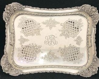 A small sampling of items in our exciting Estate Antiques Auction, August 16th, starting at 3PM!  |  Lot 143: A Tiffany & Co. makers sterling silver asparagus tray with foliate design and pierced tray insert, Chrysanthemum pattern. T date mark and marked with number 13372 / 9657. Monogrammed. 3 in tall x 12-1/2 in wide x 9-3/4 in deep. Approx 41 ozt.