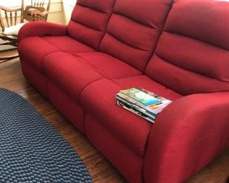 red couch with recliner ends