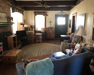Large room with lots of furniture & decor