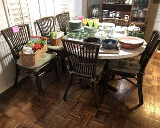 Round table with 6 Rattan chairs