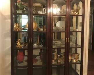Exceptional beveled glass four door display cabinet
