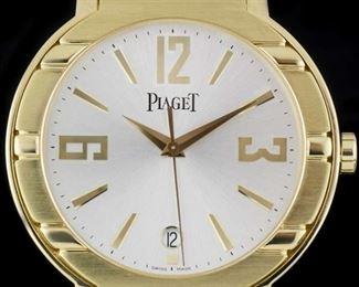 $60,000 18k gold piaget watch