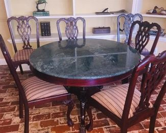 Marble top dining table with six chairs (leaves have been removed but can be added to make a larger table)