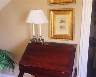 Drop front lady's writing desk--notice the prints and lamp