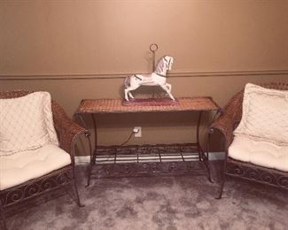 pair of  wicker chairs and matching table