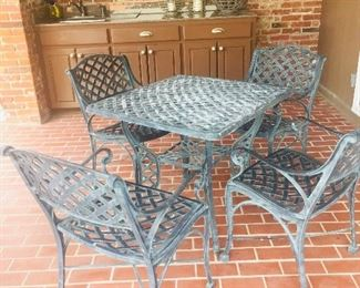 small wrought iron patio table and chairs