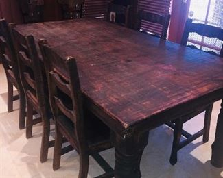 rustic table and six chairs