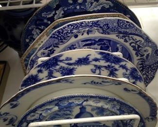 Assorted shapes and sizes of transferware plates