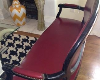 One of two matching red leather settees