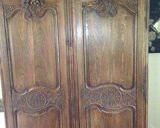 Stunning armoire with elaborate carving .  .  .