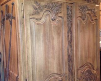 Another armoire provides more than ample storage for blankets and other linens (or whatever).
