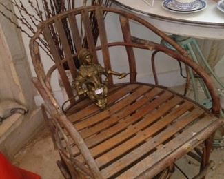 One of two barrel back wooden chairs