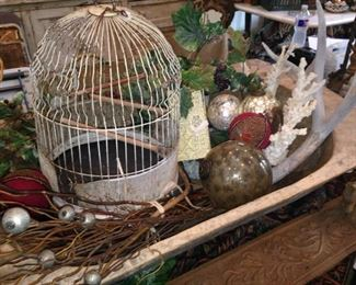 One of several rustic bird cages