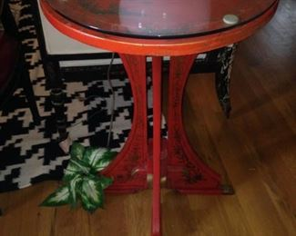 Chinese red accent table with Asian motif