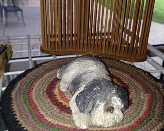 Small dog on braided rug