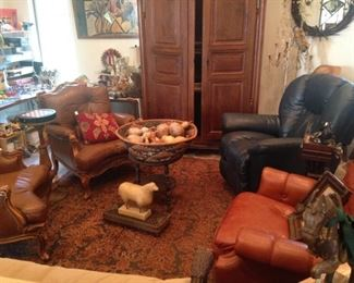 Fun room full of leather furniture and vintage toys