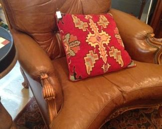 Brown leather chair; decorative pillow