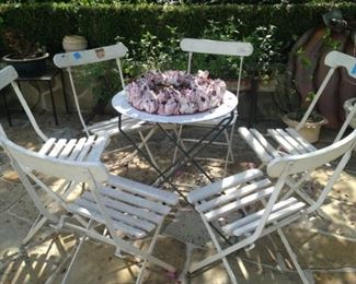 White folding chairs; small round table (sold separately)