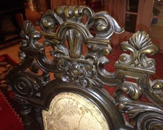 The matching chairs have detailed carving.