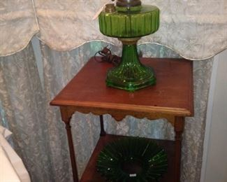 Small side table; green glass hurricane lamp