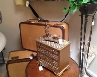 Plant stand; vintage luggage; lace umbrella; jewelry box