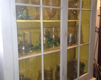 French Country hutch filled with apothecary jars