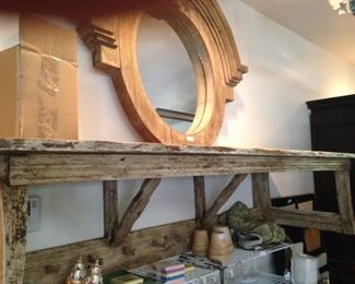 Another round frame with mirror; rustic wall unit with coat/hat hooks