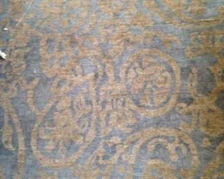 Blue/gold rug: 5 feet 7 inches x 8 feet 6 inches