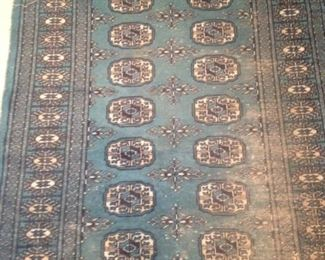 Blue rug: 5 feet 4 inches x 6 feet 1 inch
