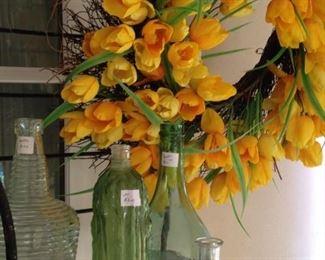 "Yellow tulip wreath; miscellaneous bottle ""vases"""