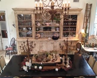 The antique wall unit has an incredible amount of display and storage areas.