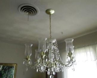 Chandelier.  Excellent condition.  Prisms all there.  Have not observed any breaks or cracks.