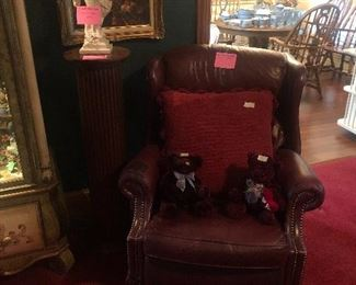 Leather recliner and oak pedestal with statue and still life framed art